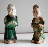 Pair of dwarfs, one with green glaze, the other with three-color glaze in green, brown, and white